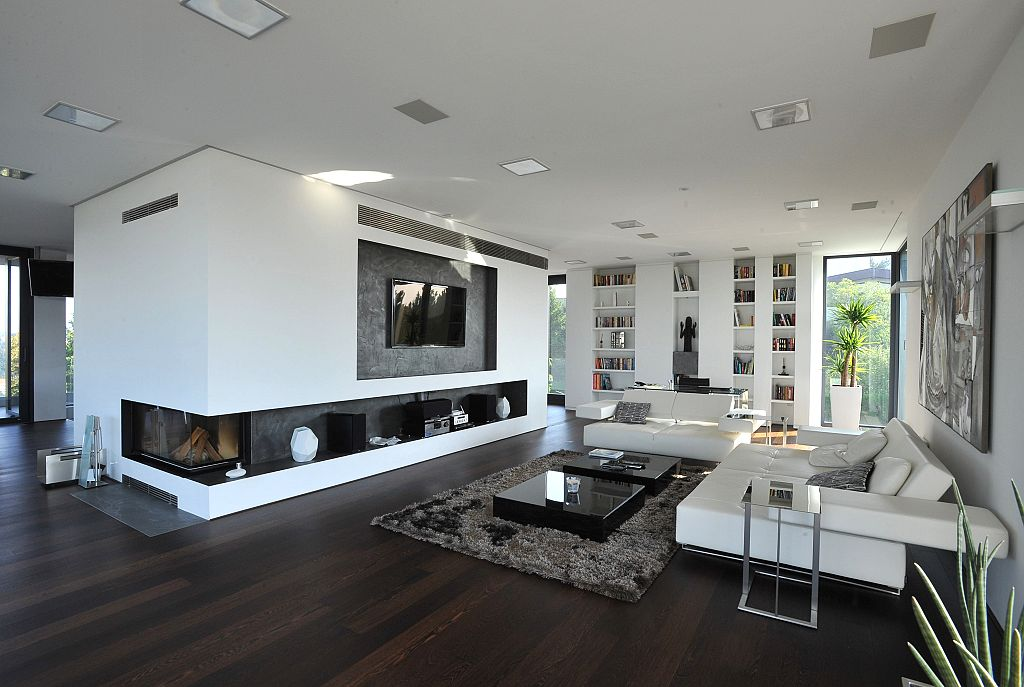 Vila Barrandov (Zumtobel) - obývací pokoj je dokola propojený s jídelnou a kuchyní